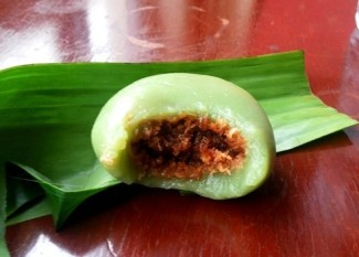 Coconut and palm sugar stuffing inside the Kuih
