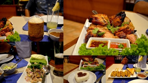 The food at C&C - Sticky rice, Whole roast chicken with honey, Pork satay, Combination rice (white and black Jasmine rice), Laab (par cooked ground pork meat salad with spicy Thai dressing served with spearmint)