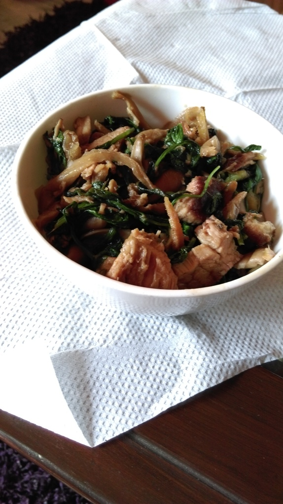 Mizo Vawksa (smoked pork with oyster mushrooms and baby spinach)