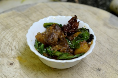 Pork curry with ghost chilly and greens