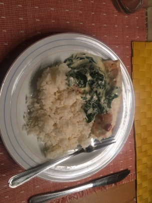 Baked salmon on bed of spinach with butter rice